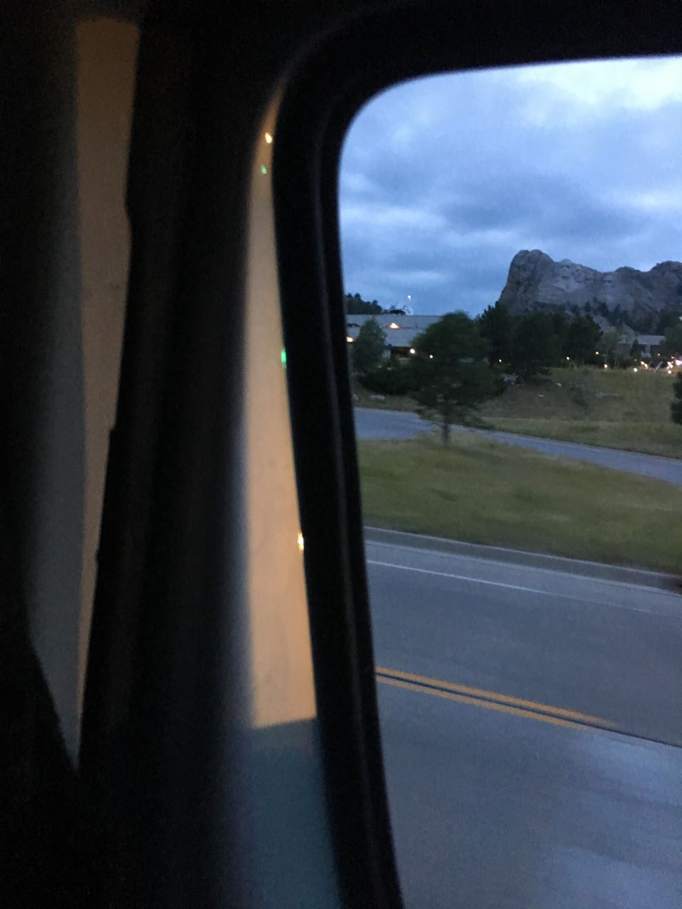 Mount Rushmore through a car window